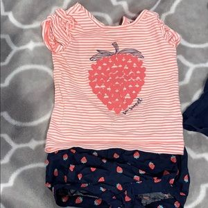 Matching strawberry baby outfits
